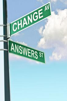 Ein Wegweiser auf dem die englischen Wörter Change(Veränderung) und Answers(Antworten) stehen
